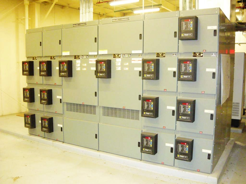 Large Hitachi electrical boxes with meters on the outside.