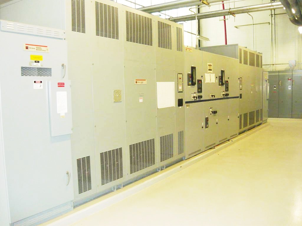 Large Hitachi electrical boxes in a large room.
