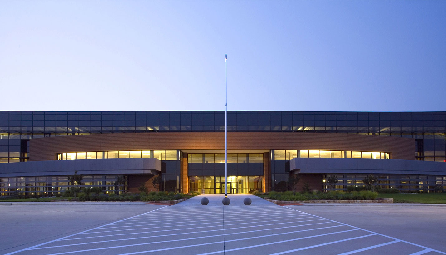 Evening view of front of Texas Instruments building in Richardson, Texas.